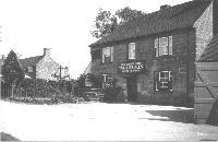 Horsted Keynes, The Crown Inn before its several fires c. 1908.