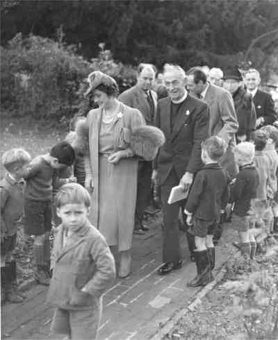 Horsted Keynes: The Queen walks up St. Gile's Church path. Is that you in the foreground?